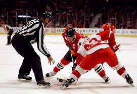 hockey faceoff referee squat1