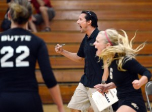 Butte College volleyball coach Dave Davis and players react to a point during a recent scrimmage against Chico State at Acker Gym.